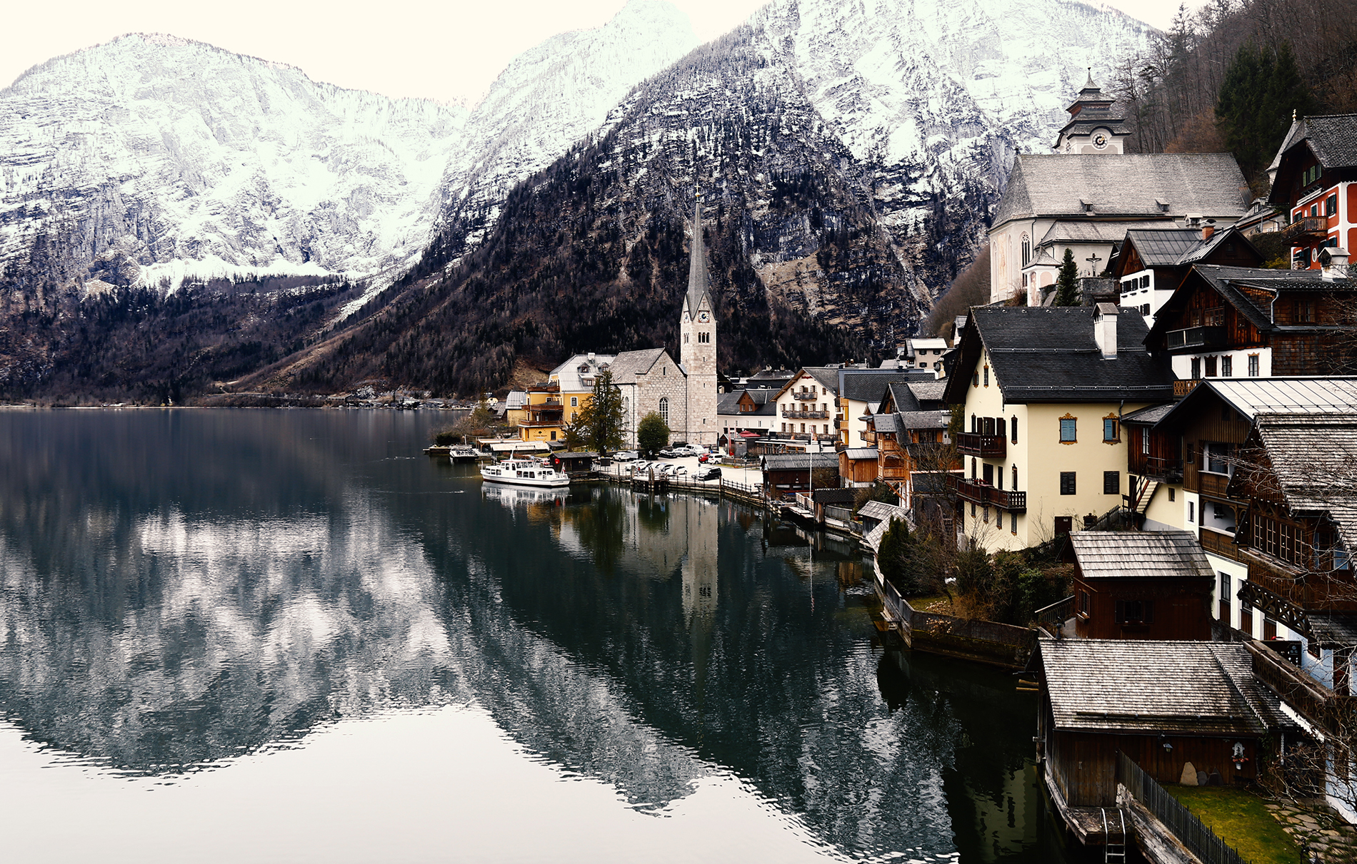 Winter View of Hallstatt, traditional austrian wood village, reflection on the lake